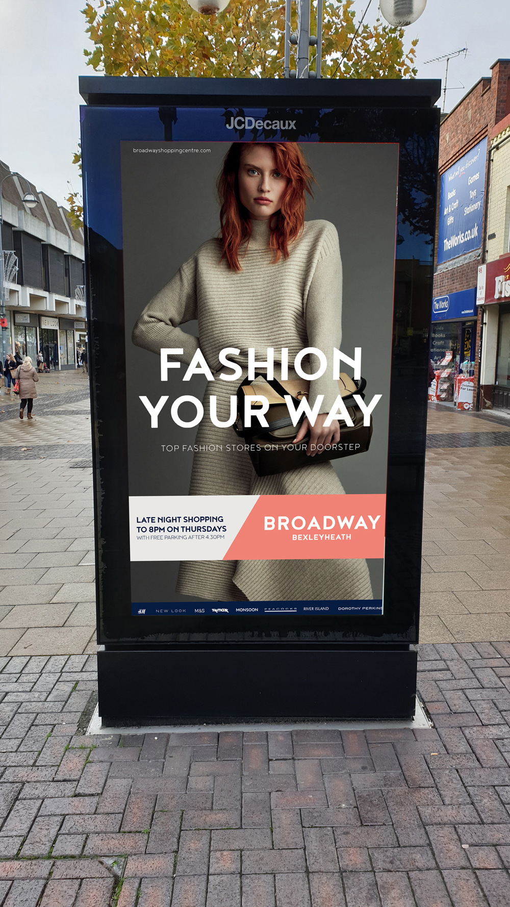 Bus stop advertising the fashion offer at a local shopping centre